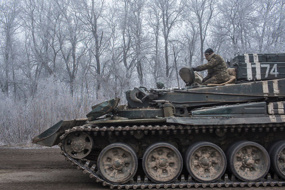 ARTEMIVSK, UKRAINE - FEBRUARY 15: A Ukrainian personnel carrier on the road leading to the embattled town of Debaltseve on February 15, 2015 outside Artemivsk, Ukraine. A ceasefire scheduled to go into effect at midnight was reportedly observed along most of the front, save for near the embattled town of Debaltseve. (Photo by Brendan Hoffman/Getty Images) *** Local Caption ***
