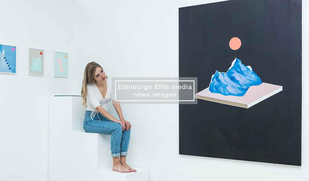 For nine days in June (1-9 June 2017), Edinburgh College of Art is transformed into vibrant gallery spaces exhibiting work from more than 500 graduating students at this year's Degree Show.<br /> <br /> For the first time, the former Fire Station on Lauriston Place – recently acquired by the University – will be used as part of Edinburgh College of Art's extensive exhibition. <br /> <br /> Work from 38 degree programmes will be on display – including architectural models, animated films, photography, textiles, jewellery and interior design.<br /> <br /> Sculpture student Michael Kay Terence's installations were inspired by the former Fire Station, where his work will be on show. The space features a bright turquoise Mini, which has been cut in half and crash-landed. <br /> <br /> Rachel McLellan has explored the themes of identity and tribalism by creating a giant web of brightly coloured T-shirts, emblazoned with slogans.<br /> <br /> Pictured: