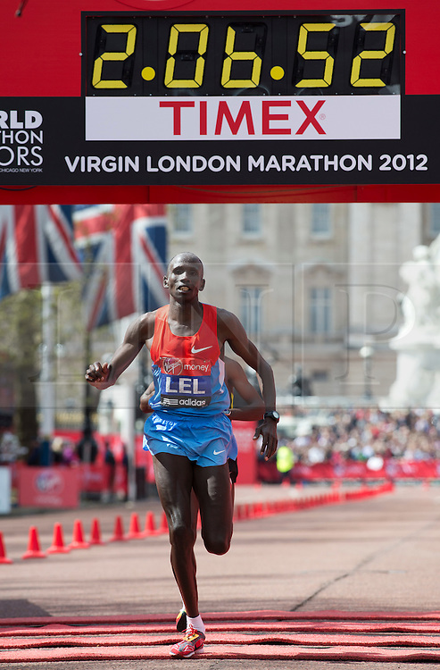 © London News Pictures. 22/04/2012. London, UK. Martin Lel crosses the finnish line to come second in the men's elite race at the 2012 Virgin London Marathon in London on April 22, 2012. Photo credit : Ben Cawthra /LNP