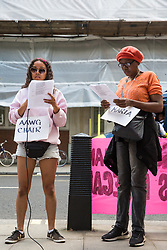 London, UK. 29 July, 2019. Activists from Reclaim the Power, All African Women's Group, Docs Not Cops, Lesbians and Gays Support the Migrants and other groups protest outside the Home Office to demand an end to the Government's 'hostile environment' policies.