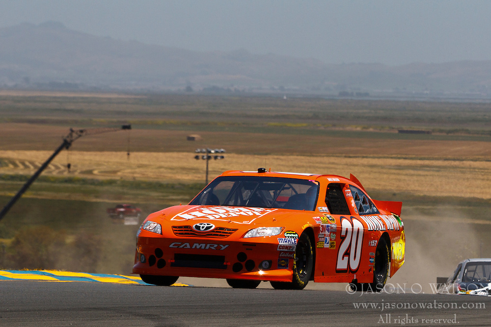 June 26, 2011; Sonoma, CA, USA;  NASCAR Sprint Cup Series driver Joey Logano (20) in turn 2 during the Toyota/Save Mart 350 at Infineon Raceway.