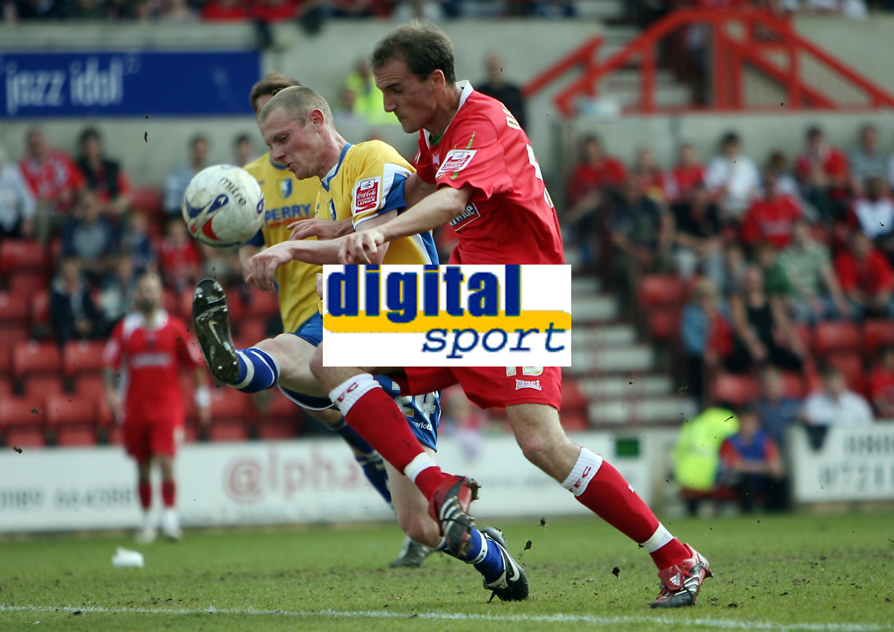 Photo: Rich Eaton.<br /> <br /> Swindon Town v Mansfield Town. Coca Cola League 2. 21/04/2007. Andy Nicholas #15 right of Swindon gets past Mansfield defender Chris Wood left