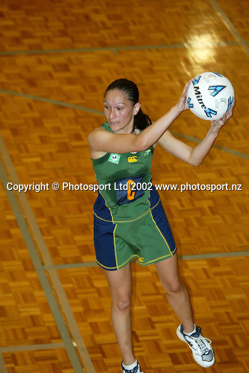 Tia Raemka in action during the National Bank Cup netball match between the Auckland Diamonds and Western Flyers, 6th April 2002 at Unitec, Auckland. Photo: Sandra Teddy/PHOTOSPORT<br />