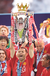 WIGAN, ENGLAND - Sunday, May 11, 2008: Manchester United's Ryan Giggs lifts the trophy after winning the Premier League for the 10th time after the final Premiership match of the season at the JJB Stadium. (Photo by David Rawcliffe/Propaganda)