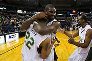 Norfolk State's Kyle O'Quinn hugs Kris Brown (22) after their 73-70 win over Bethune-Cookman in the championship game of the 2012 MEAC Basketball Tournament at the Lawrence Joel Memorial Coliseum in Winston-Salem, North Carolina.  March 10, 2012  (Photo by Mark W. Sutton)