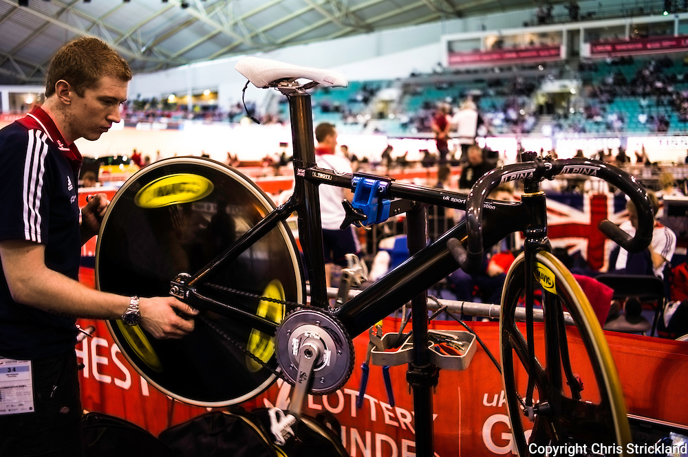 UCI Track World Cup, Manchester, UK. November 2013. A mechanic prepares Laura Trott's race bike.