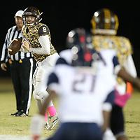East Union quarterback Josh Basil looks down field for his receiver in the first quarter against Baldwyn Thursday night.