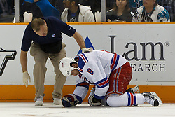 March 12, 2011; San Jose, CA, USA;  New York Rangers head trainer Jim Ramsey (left) attends to right wing Brandon Prust (8) after he was knocked to the ice during the first period against the San Jose Sharks at HP Pavilion. New York defeated San Jose 3-2 in shootouts. Mandatory Credit: Jason O. Watson / US PRESSWIRE