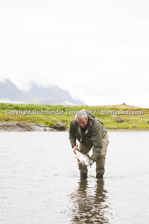 Tómas Guðmundsson fly fishing for atlantic salmon at the pool Klapparhylur on the river Breiðdalsá, Iceland.