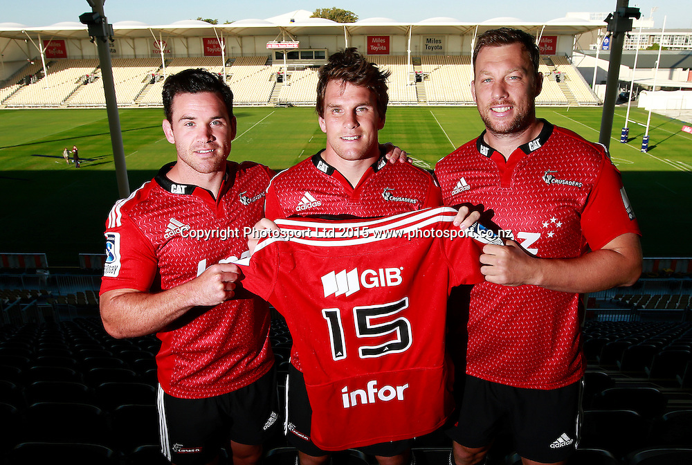 "Ryan Crotty of the Crusaders, Matt Todd and Wyatt Crockett pose with the Crusaders jersey with the new ""infor"" sponsors logo on the back at a Crusaders back Sponsor announcement of infor and Crusaders captains run training session held at AMI Stadium, Christchurch. 12 February 2015 Photo: Joseph Johnson / www.photosport.co.nz"
