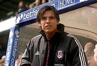 Chris Coleman (Fulham caretaker Manager) watches from the bench. Fulham v Newcastle United. 19/4/2003. Credit : Colorsport/Andrew Cowie.