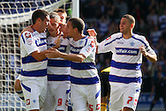 Loftus Road, London - Saturday 11th September 2010: Heidar Helguson (9) of QPR celebrates their first goal with Bradley Orr (2) of QPR,q5 and Adel Taarabt (7) of QPR during the Npower Championship match between Queens Park Rangers and Middlesborough. (Photo by Andrew Tobin/Focus Images)
