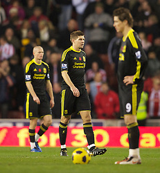 STOKE, ENGLAND - Saturday, November 13, 2010: Liverpool's captain Steven Gerrard MBE looks dejected after his side concede Stoke City's opening goal during the Premiership match against Stoke City at the Britannia Stadium. (Photo by David Rawcliffe/Propaganda)