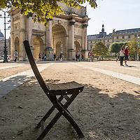 Café chair next to Arc de Triomphe Paris France