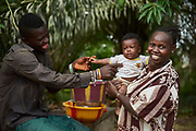 Community health worker Nancy Tucker, 42 holds 5 month old baby Samuel with Samuel's father Tamba Amsumana at her home in the village of Bambaya, Kono district, Sierra Leone on March 28, 2017. Nancy became a CHW in 2008 and has been providing maternal and child health related services to her community. &ldquo;As a CHW, I counsel pregnant women in my village about the importance of accessing ante-natal care services at the health facility and also giving birth there. I advise them to take all their vaccines. I also convince them to exclusively breastfeed their babies for at least six months after they give birth and educate them on good hygiene practices,&rdquo; she said.<br />  <br /> &ldquo;One thing I am proud of is helping to save the life of a bleeding pregnant woman and her baby. I acted fast and ensured we took her to the health center where she received help. Even though there was no car or motor bike I insisted that we go with her immediate and we carried her on a hammock. That woman and her baby might have died if I didn&rsquo;t intervene.&rdquo; Nancy Tucker <br /> <br /> &ldquo;We are really grateful to have aunty Nancy as a CHW in our village. I am happy about the way she does her job. Even when my wife was pregnant, she monitored her to ensure that she went for all her ante-natal sessions, took all the prescribed vaccines and gave birth at the clinic and she didn&rsquo;t ask us for anything. Our son is five months old now. He is very healthy and has never been sick since he was born because we are following the advice she gave us including to exclusively breastfeed him until he is six months, to always sleep under a bed net etc.&rdquo;  Tamba Ansumana, 27 years old