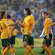 Brett Holman (left) congratulates Josh Kennedy at the end of the match during the 2010 Fifa World Cup Asian Qualifying match between Australia and Uzbekistan at Stadium Australia in Sydney, Australia on April 01, 2009. Australia won the match 2-0.  Photo Tim Clayton