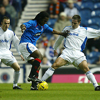 Rangers v St Johnstone....03.12.03<br />Emerson is tackled by Paul Bernard and Mark Robertson<br /><br />Picture by Graeme Hart.<br />Copyright Perthshire Picture Agency<br />Tel: 01738 623350  Mobile: 07990 594431