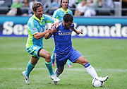 July 18, 2012: CenturyLink Field, Seattle, WA: Sounders FC Jeff Parke fights for the ball against Chelsea FC Yossi Benayoun during the World Football Challenge. Chelsea FC led the Seattle Sounders 4-2 at the half.