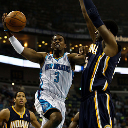 April 3, 2011; New Orleans, LA, USA; New Orleans Hornets point guard Chris Paul (3) shoots over Indiana Pacers center Roy Hibbert (55) during the first quarter at the New Orleans Arena.    Mandatory Credit: Derick E. Hingle