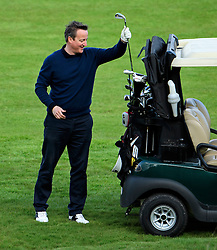 © Licensed to London News Pictures. 23/04/2016. Chandler's Cross, UK. DAVID CAMERON choosing a club. President of The United States of America, BARAK OBAMA, playing golf with British prime minister DAVID CAMERON at The Grove golf Course in Chandler's Cross, Hertfordshire. Photo credit: Ben Cawthra/LNP