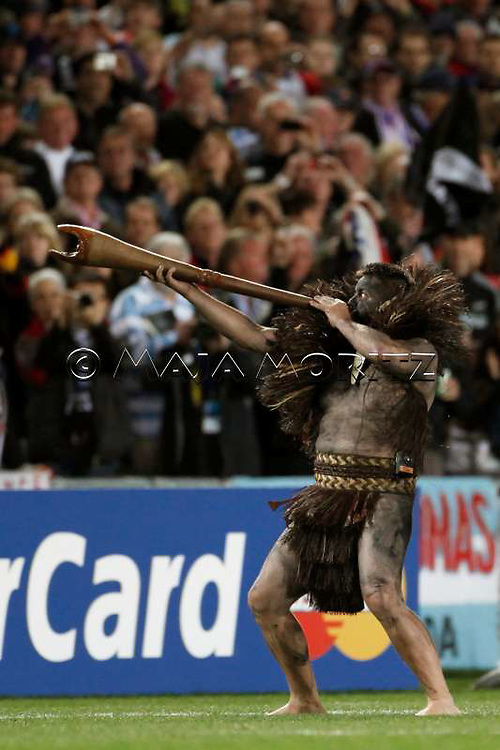 The Maori warrior calls the teams onto the field of play, today with a blackened face and body parts as a tribute to the All Blacks