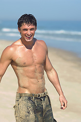 shirtless good looking man at the beach in East Hampton, NY