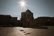 The empty main square of the historical center city . On 6 April 2009 a strong earthquake hit the city of L'Aquila, in the central Abruzzo region of Italy, leaving 308 dead and tens of thousand homeless. 4  years after In the historical center of the city few signs of reconstructions could be seen. On the other hand the effects of the of abandonment add up to the destruction of the quake. .