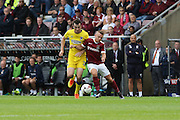 AFC Wimbledon defender Sean Kelly (22) and Northampton Town striker Sam Hoskins (14) tussle during the EFL Sky Bet League 1 match between Northampton Town and AFC Wimbledon at Sixfields Stadium, Northampton, England on 20 August 2016. Photo by Stuart Butcher.