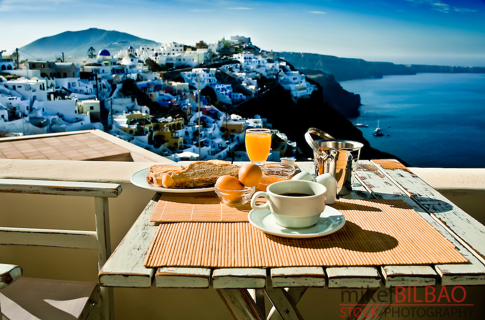Breakfast and view.<br /> Firostefani village. Santorini island, Greece, Europe