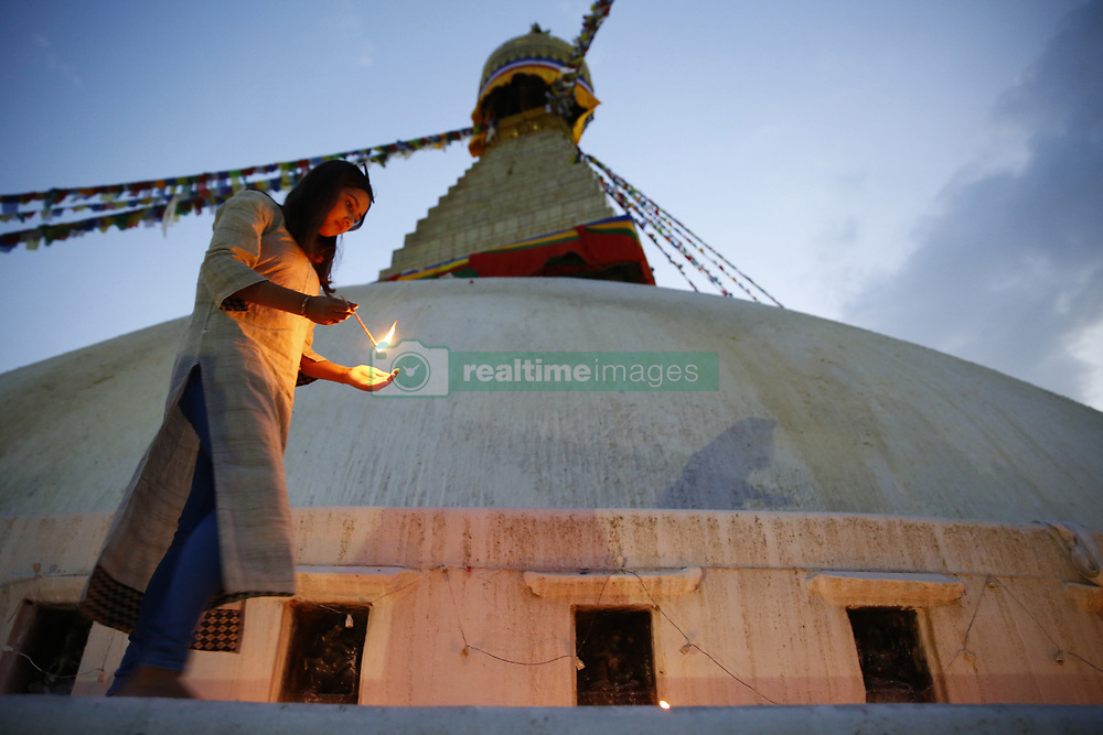 April 25, 2017 - Kathmandu, Nepal - A Nepalese woman light candles while taking rounds around the Boudhanath Stupa in remembrance and memory of those lives lost to mark the 2nd anniversary of the 2015 Nepal Earthquake in Kathmandu. (Credit Image: © Skanda Gautam via ZUMA Wire)