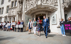 © Licensed to London News Pictures. 07/06/2018. London, UK. Sarah Ewart, a Northern Ireland resident and abortion campaigner (centre-left) and Grainne Teggart, Amnesty campaigner (centre right) leave the Supreme Court after the court said it could not rule on an appeal against Northern Ireland's strict abortion laws, but that it would have declared them incompatible with human rights laws otherwise. Photo credit: Rob Pinney/LNP