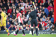 Brentford attacker, Sergi Canos (47) yellow card during the Sky Bet Championship match between Brentford and Fulham at Griffin Park, London, England on 30 April 2016. Photo by Matthew Redman.