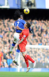 Everton's Romelu Lukaku beats Liverpool's Daniel Agger to the header - Photo mandatory by-line: Dougie Allward/JMP - Tel: Mobile: 07966 386802 23/11/2013 - SPORT - Football - Liverpool - Merseyside derby - Goodison Park - Everton v Liverpool - Barclays Premier League