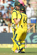 Phillip Hughes of Australia congratulates Shane Watson of Australia on his fifty  during the 2nd One Day International (ODI) match in the Star Sports Series between India and Australia held at the Sawai Mansingh Stadium in Jaipur on the 16th October 2013<br /> <br /> Photo by Ron Gaunt-BCCI-SPORTZPICS<br /> <br /> Use of this image is subject to the terms and conditions as outlined by the BCCI. These terms can be found by following this link:<br /> <br /> http://sportzpics.photoshelter.com/gallery/BCCI-Image-terms-and-conditions/G00004IIt7eWyCv4/C0000ubZaQCkIRgQ