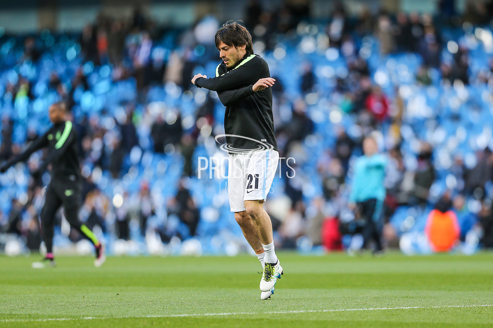 Manchester City's David Silva warming up ahead of the Champions League match between Manchester City and Real Madrid at the Etihad Stadium, Manchester, England on 26 April 2016. Photo by Shane Healey.