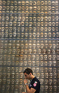 A member of Red Cross Italy visits La Chiesa Ossario in Solferino, Italy on June 21, 2014.  The ossuary gathers more than 2500 skulls and bones of the fallen 7000 of the three armies faced each other June 24, 1859 in the bloody Battle of Solferino and San Martino, Italy.<br /> (Photo by Kuni Takahashi)