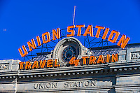 "The old Union Station ""Travel by Train"" neon sign above the newly renovated Denver Union train station, Downtown Denver, Colorado USA."