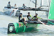 Groupama helmed by Franck Cammas. Day three of the Extreme Sailing Series regatta being sailed in Singapore. 22/2/2014