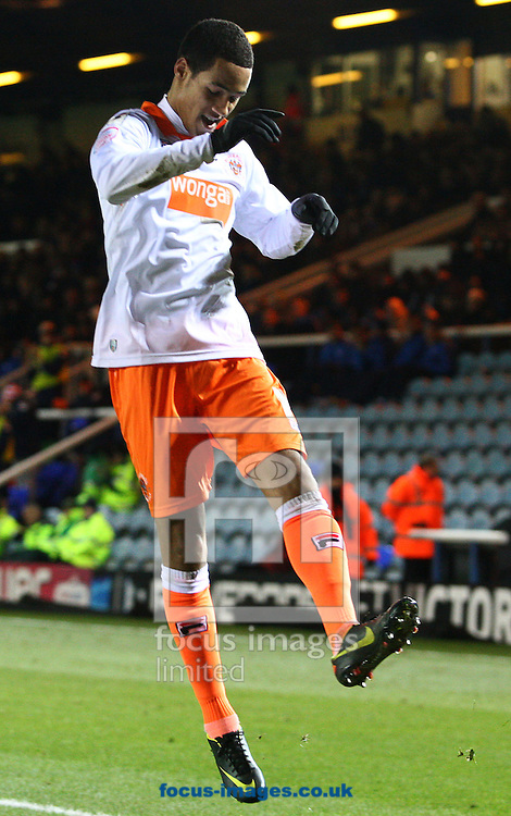 Picture by Rob Fisher/Focus Images Ltd +44 7545 398891.01/12/2012.Thomas Ince of Blackpool celebrates scoring their 4th goal - his 2nd; by jumping in the air during the npower Championship match at London Road, Peterborough.