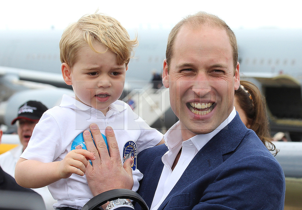 ©  London News Pictures. 08/07/2016. RAF Fairford, UK. Prince WILLIAM, Duke of Cambridge and Prince GEORGE  during a visit to the International Air Tattoo at RAF Fairford in Gloucestershire where Prince George was introduced to the Red Arrows.  Photo credit: Ian Schofield/LNP