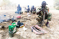Cleaning weapons while on a counter poaching patrol, Zakouma National Park, Chad