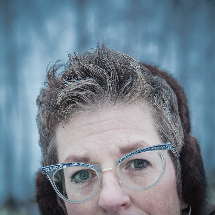 """Wendy Isbell and her daughters Tina and Becky in Anchorage's South addition neighborhood.  """"I have eight pairs of glasses.  I bought these in a thrift shop.""""  farbell@ak.net"""