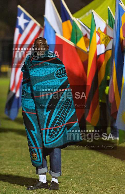 DURBAN, SOUTH AFRICA - JUNE 21: a man wrapped in a blanket sings the African Union anthem during the CAA 20th African Senior Championships Opening Ceremony at Growth Point Kings Park stadium on June 21, 2016 in Durban, South Africa. (Photo by Roger Sedres/Gallo Images)