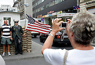 GERMANY - BERLIN - Tourists posing with fake gards at Checkpoint Charlie.  PHOTO  GERRIT DE HEUS
