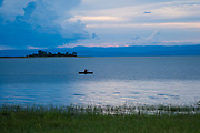 Fishing boat on Lake Kariba, Zimbabwe at sunset