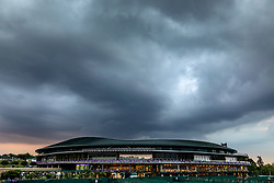 Rain falls on day three of the Wimbledon Championships at the All England Lawn Tennis and Croquet Club, Wimbledon.