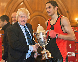 © licensed to London News Pictures. London, UK. 25/11/2011. Mayor of London Boris Johnson giving presenting the Mayors Boxing Cup to Jamal Akay, the winner of the tournament at Mayor's Boxing Cup in Porchester Hall West London. Photo credit: Tolga Akmen/LNP