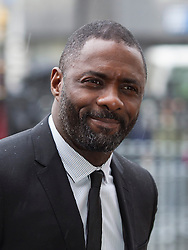 LONDON- UK- 03- MAR-2014: Britain's Prince Harry represents The Queen at a National Service of Thanksgiving to celebrate the life of Nelson Mandela, former President of the Republic of South Africa. Westminster Abbey, London.<br /> Idris Elba. Actor<br /> Photograph by Ian Jones