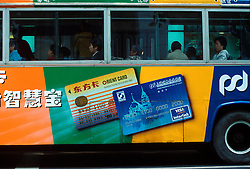 CHINA SHANGHAI NOV01 - Local bus carrying advertisements for electronic forms of payment in downtown Shangahi.. . . jre/Photo by Jiri Rezac. . © Jiri Rezac 2001. . Contact: +44 (0) 7050 110 417. Mobile:  +44 (0) 7801 337 683. Office:  +44 (0) 20 8968 9635. . Email:   jiri@jirirezac.com. Web:     www.jirirezac.com