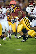University of Southern California Trojan running back LenDale White runs through the defensive line during a 70 to 17 win over the Arkansas Razorbacks on September 17, 2005 at Los Angeles Memorial Coliseum in Los Angeles, California.